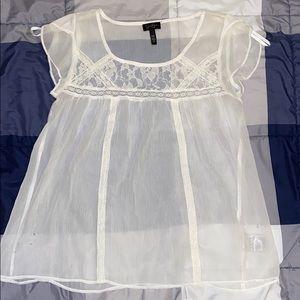 Jessica Simpson translucent white shirt